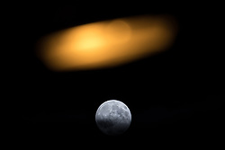 © Licensed to London News Pictures . 08/06/2017 . Manchester , UK . Full moon outside the Manchester Central Convention Centre where the count for the constituencies of Blackley and Broughton, Manchester Central, Manchester Gorton, Manchester Withington and Wythenshawe and Sale East, in the General Election, is taking place . Photo credit : Joel Goodman/LNP