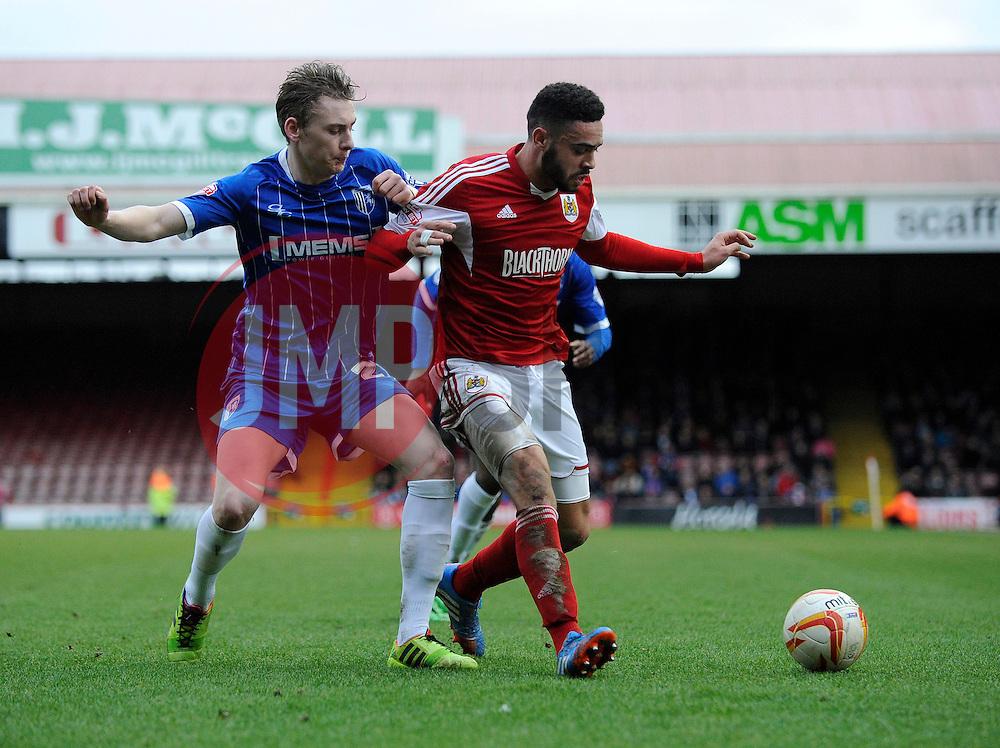Bristol City's Derrick Williams is challenged to the ball - Photo mandatory by-line: Dougie Allward/JMP - Tel: Mobile: 07966 386802 01/03/2014 - SPORT - FOOTBALL - Bristol - Ashton Gate - Bristol City v Gillingham - Sky Bet League One