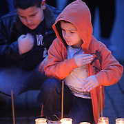 Young boys join other members of the public paying their respects at the shrine set up around the towns Christmas tree in Sandy Hook after the mass shootings at Sandy Hook Elementary School, Newtown, Connecticut, USA. 16th December 2012. Photo Tim Clayton