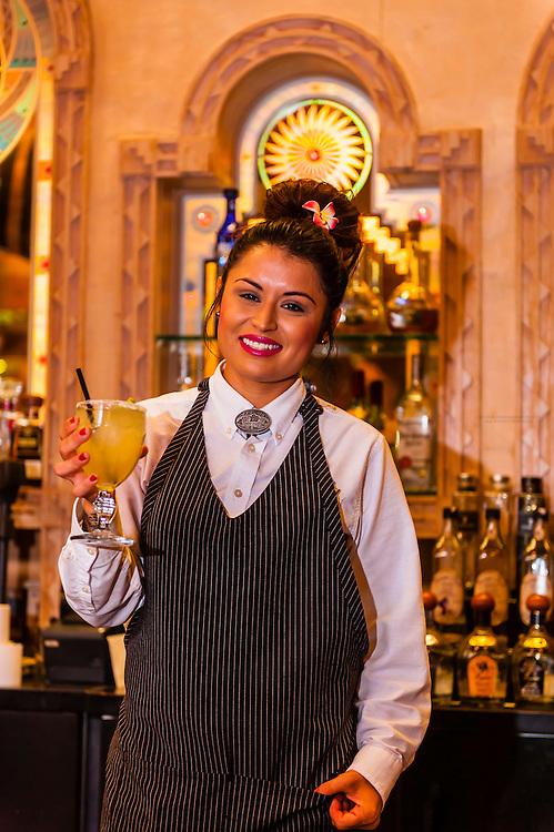 A bartender holds a freshly made margarita, El Pinto Restaurant and Cantina, Albuquerque, New Mexico USA