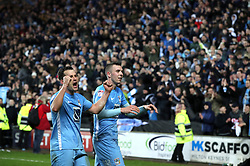 Coventry City's Michael Doyle and Jordan Shipley celebrate after the final whistle of the Emirates FA Cup  Fourth Round match at  Stadium MK Milton Keynes.