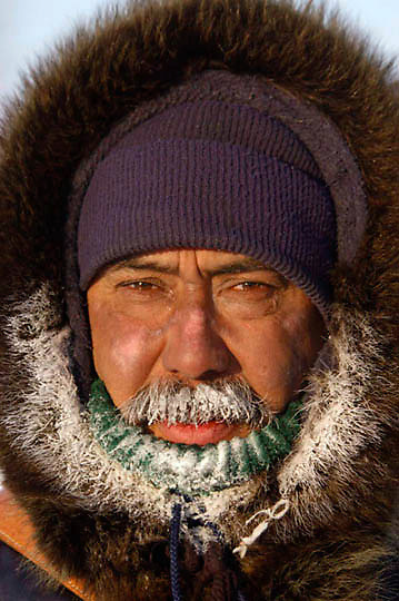 Morris Spence, a master polar bear tracker, covered in frost and ice from his breath freezing to his coats fur in -40F temperatures. Morris guides photographers in Wapusk National Park near Hudson Bay, Manitoba, Canada.