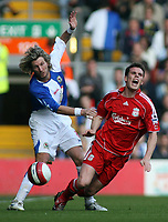 Photo: Paul Thomas.<br /> Liverpool v Blackburn Rovers. The Barclays Premiership. 14/10/2006.<br /> <br /> Robbie Savage (L) of Blackburn fouls Steve Finnan.