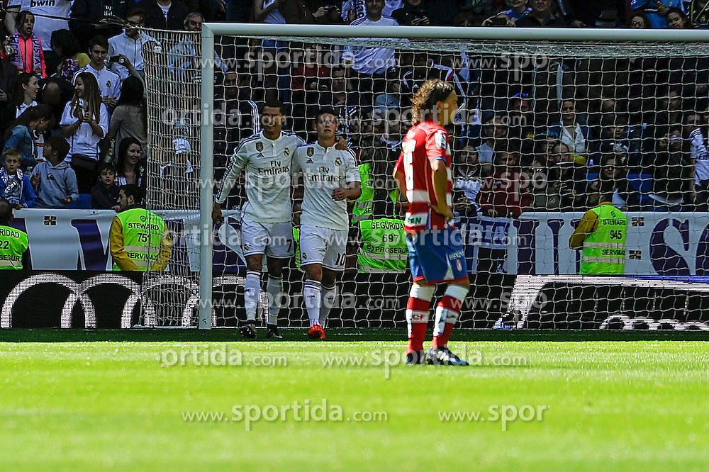 05.04.2015, Estadio Santiago Bernabeu, Madrid, ESP, Primera Division, Real Madrid vs FC Granada, 29. Runde, im Bild Real Madrid&acute;s Cristiano Ronaldo and James Rodriguez celebrates a goal // during the Spanish Primera Division 29th round match between Real Madrid CF and Granada FC at the Estadio Santiago Bernabeu in Madrid, Spain on 2015/04/05. EXPA Pictures &copy; 2015, PhotoCredit: EXPA/ Alterphotos/ Luis Fernandez<br /> <br /> *****ATTENTION - OUT of ESP, SUI*****