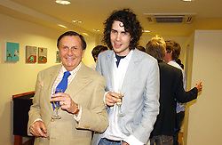 Left to right, BARRY HUMPHRIES and RUPERT HUMPHRIES at an exhibition of art by Oscar Humphries entitles 'Post-Nuclear Family' held at Nutters, Lower Ground, 12 Savile Row, London on 8th June 2006.<br />