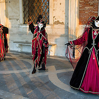 VENICE, ITALY - FEBRUARY 25:  Three people dressed in Carnival Costumes pose at the Doge Palace on February 25, 2014 in Venice, Italy. The 2014 Carnival of Venice will run from February 15 to March 4 and includes a program of gala dinners, parades, dances, masked balls and music events.  (Photo by Marco Secchi/Getty Images)