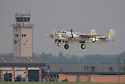 "The ""Miss Mitchell"" B-25J Mitchell bomber from the St.Paul, Minnesota Wing of the Commemorative Air Force (CAF) takes off from Kelly Field and pass by the control tower on April 20, 2007. Three North American B-25 Mitchell bombers of the CAF were viewed by military families at Kelly Field, Lackland Air Force Base, TX on April 20, 2007. After the viewing, the three bombers made a 3-ship formation flyby of the Basic Military Training airmen graduation ceremonies. the aircraft were at Lackland Air Force Base to commemorate the 65th anniversary of the Doolittle air raid of Tokyo, Japan, the surviving airmen were present for a reunion during the week. (Photo copyright 2007 Lance Cheung).."