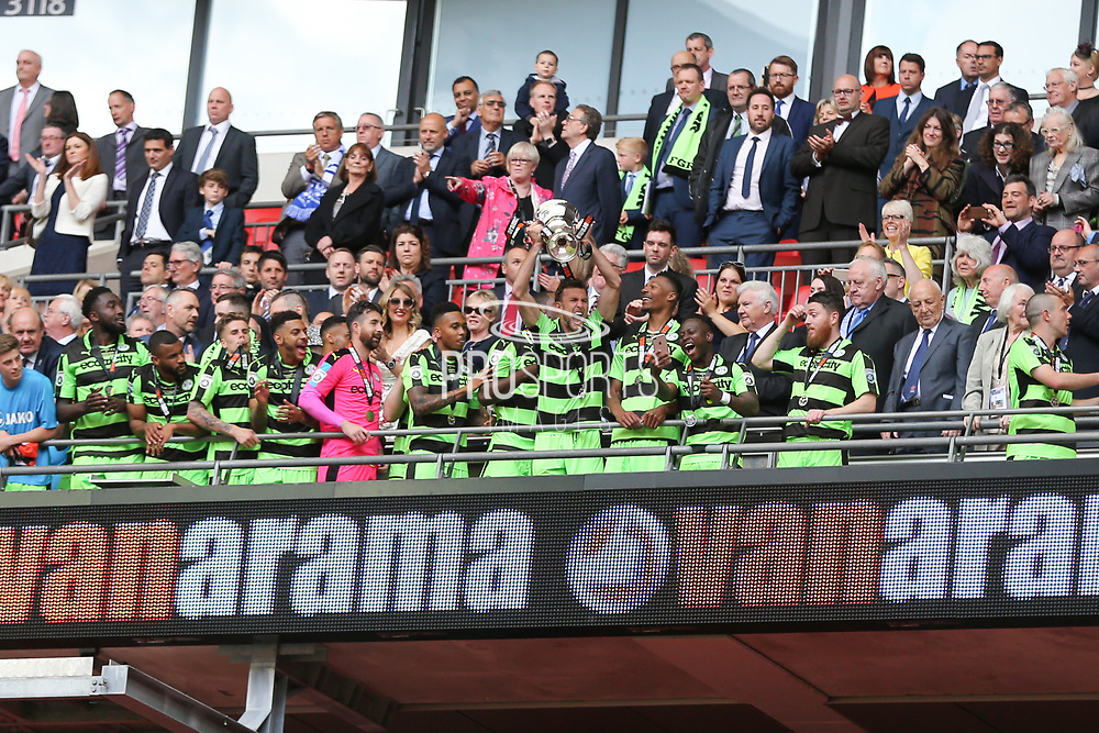 Forest Green Rovers Christian Doidge(9) lifts the trophy during the Vanarama National League Play Off Final match between Tranmere Rovers and Forest Green Rovers at Wembley Stadium, London, England on 14 May 2017. Photo by Shane Healey.