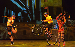 "© Licensed to London News Pictures. 30/09/2013. London, England. Pictured: Thibaut Philippe on the trial bike. The 15 performers from the Canadian troupe Cirque Éloize perform their show ""iD"" at London's Peacock Theatre from 1 to 19 October 2013. ""iD"" is a blend of circus arts and urban dance. Photo credit: Bettina Strenske/LNP"