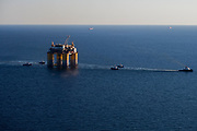 """Offshore oil rig """"Stampede"""" being towed out by Crowley and Signet Maritime Tug boats from Kiewit Offshore Services in Ingleside, TX on Friday and Saturday May 5th and 6th to the Gulf of Mexico. (Photo by Tim Burdick)"""