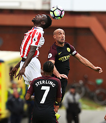 Mame Biram Diouf of Stoke City challenges for a header with Pablo Zabaleta of Manchester City  - Mandatory by-line: Matt McNulty/JMP - 20/08/2016 - FOOTBALL - Bet365 Stadium - Stoke-on-Trent, England - Stoke City v Manchester City - Premier League