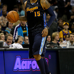 Dec 18, 2009; New Orleans, LA, USA; Denver Nuggets forward Carmelo Anthony (15) controls the ball against the New Orleans Hornets during the second half at the New Orleans Arena. The Hornets defeated the Nuggets 98-92. Mandatory Credit: Derick E. Hingle-US PRESSWIRE