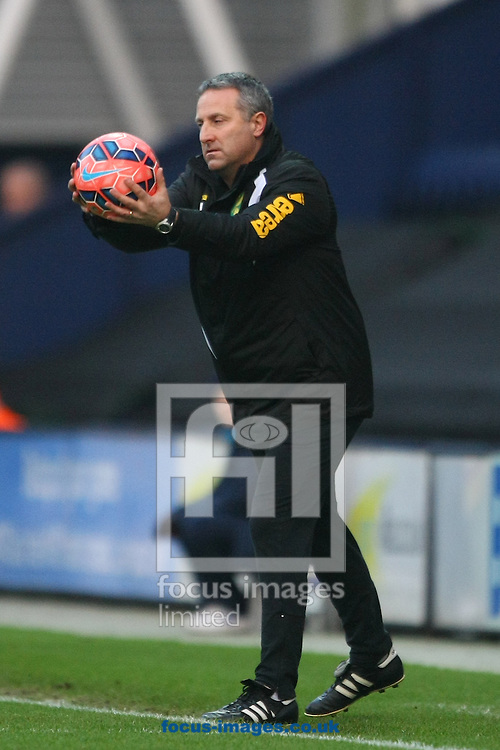 Norwich Manager Neil Adams acts as ballboy during the FA Cup match at Deepdale, Preston<br /> Picture by Paul Chesterton/Focus Images Ltd +44 7904 640267<br /> 03/01/2015
