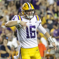 Sep 23, 2017; Baton Rouge, LA, USA; LSU Tigers quarterback Danny Etling (16) celebrates after a touchdown throw to wide receiver Stephen Sullivan (not pictured) during the second quarter of a game against the Syracuse Orange at Tiger Stadium. Mandatory Credit: Derick E. Hingle-USA TODAY Sports