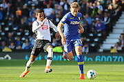 Leeds United defender Charlie Taylor (21) wins the ball from Derby County midfielder Tom Ince (10) during the EFL Sky Bet Championship match between Derby County and Leeds United at the iPro Stadium, Derby, England on 15 October 2016. Photo by Aaron  Lupton.