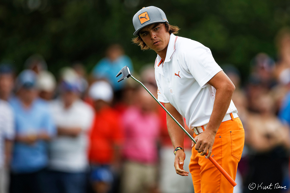 RICKIE FOWLER prepares for his putt on the first hole during the final round of the Arnold Palmer Invitational at the Bay Hill Club and Lodge.