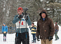 Sam Aldridge of Gilford steadies and takes aim at the target while official Troy Schrupp tallies the hits during Gunstock Nordic's annual Paintball Biathlon event Sunday morning.  (Karen Bobotas/for the Laconia Daily Sun)