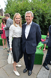 KATE REARDON and CHARLES GORDON-WATSON at the launch of Chelsea Thoroughbreds held at St.Luke's Church, Sydney Street, London on 2nd July 2014.