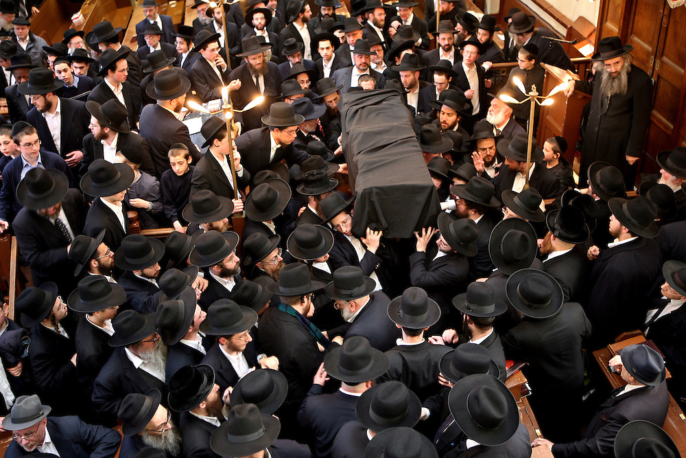 The coffin of Rabbi Josef Dunner who died on the 1st of April 2007 is surrounded in the Adath Yisroel synagogue, Stamford Hill, London for his funeral. Rabbi Dunner was one of the last German Jewish Orthodox Rabbis ordained before the holocaust and well respected within the local community, hundreds of people attended his funeral.