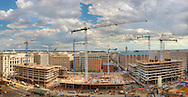 Construction cranes fill the sky over the CityCenterDC site in June of 2012.  The Capitol and Washington Monument are within the view.<br />
