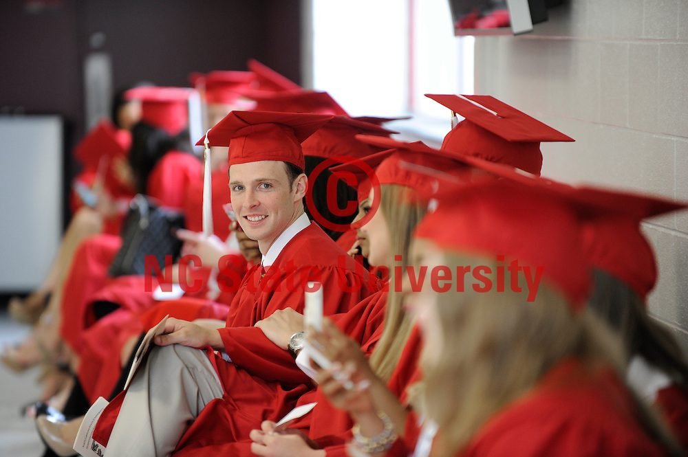 Students are all smiles as the wait for the graduation ceremony to begin for the Interdisciplinary studies masters program. Photo by Marc Hall