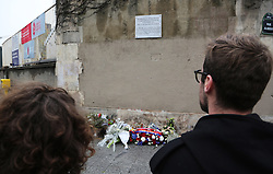 People pay tribute to victims of a terror attack in front of Le Petit Cambodge and Le carillon restaurants in Paris, France, on November 13, 2016, marking the one year anniversary of a series of deadly attacks. Some 130 were killed, 90 of them at Bataclan, when Islamic militants went of the rampage in the heart of the French capital. Photo by Somer/ABACAPRESS.COM