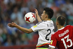 June 24, 2017 - Kazan, Russia - Hirving Lozano (L) of Mexico national team and Fedor Kudriashov of Russia national team vie for the ball during the Group A - FIFA Confederations Cup Russia 2017 match between Russia and Mexico at Kazan Arena on June 24, 2017 in Kazan, Russia. (Credit Image: © Mike Kireev/NurPhoto via ZUMA Press)