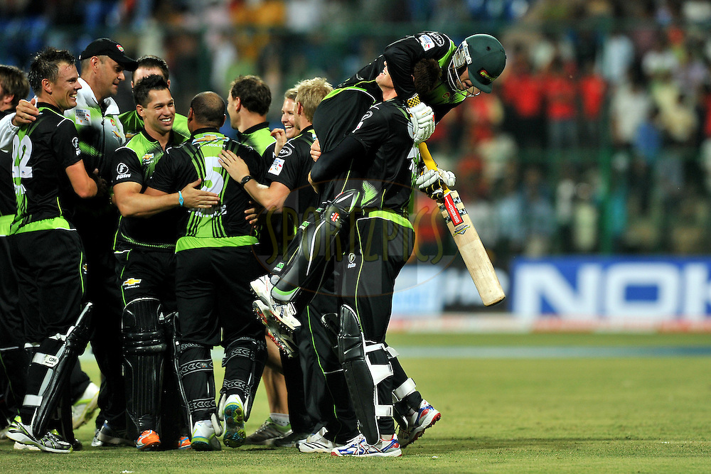 Team Warriors celebrate after winning the match 1 of the NOKIA Champions League T20 ( CLT20 )between the Royal Challengers Bangalore and the Warriors held at the  M.Chinnaswamy Stadium in Bangalore , Karnataka, India on the 23rd September 2011..Photo by Pal Pillai/BCCI/SPORTZPICS