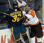 2010/03/19 - RIT's Cameron Burt checks Peter MacDougall of Canisius. RIT defeated Canisius 4-0 in the Atlantic Hockey semifinal at the Blue Cross Arena in Rochester, N.Y. on March 19th, 2010.
