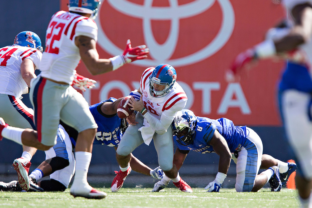 MEMPHIS, TN - OCTOBER 17:  Chad Kelly #10 of the Ole Miss Rebels is sacked and fumbles the ball by Genard Avery #6 of the Memphis Tigers at Liberty Bowl Memorial Stadium on October 17, 2015 in Memphis, Tennessee.  The Tigers defeated the Rebels 37-24.  (Photo by Wesley Hitt/Getty Images) *** Local Caption *** Chad Kelly; Genard Avery
