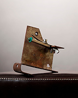 Aaron Creamer's first homemade tattoo machine, made by bending a piece of sheet metal. Aaron has since made machines by casting molten metal, and has recently taken up welding in order to make his own frames with that technology as well.