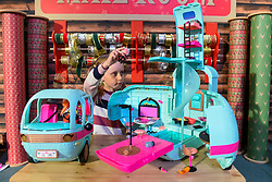 """© Licensed to London News Pictures. 13/11/2019. LONDON, UK. Gwen (aged 8) plays with L.O.L. Surprise! 2-in-1 Glamper by MGA Entertainment at the preview of """"DreamToys"""", the official toys and games Christmas Preview, held at St Mary's Church in Marylebone.  Recognised as the countdown to Christmas, the Toy Retailer's Association, an independent panel of leading UK toy retailers, have selected the definitive and most authoritative list of which toys will be the hottest property this Christmas.  Photo credit: Stephen Chung/LNP"""
