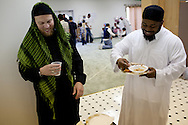 Abdul Hakim and Rashid Weekley travel from Parsons and Ft. Scott, respectively, to attend Pittsburg Masjid. Members of the Islamic Society of Southeast Kansas celebrated Eid ul-Fitr with a morning feast at their Mosque in Pittsburg, Kansas, Sep. 10, 2010. The Mosque, founded in 1999, is the only one in Southeast Kansas. It serviced Northeast Oklahoma and Southwest Missouri until a newer mosque was established in Joplin, MO a few years ago.
