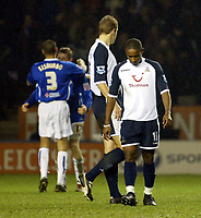 Photo: Chris Ratcliffe.<br /> Leicester City v Tottenham Hotspur. The FA Cup.<br /> 08/01/2006.<br /> Jermaine Defoe and Michael Dawson are gutted as Leicester players celebrate victory in the background
