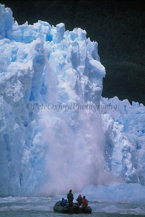Zodiac with Tourists & Calving Glacier<br />Ice Shelf<br />San Raphael,  CHILE.   South America