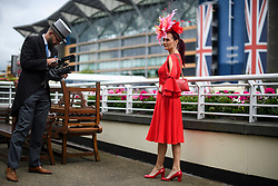 © Licensed to London News Pictures. 19/06/2018. London, UK.  A racegoer poses for a video while attending day one of Royal Ascot at Ascot racecourse in Berkshire, on June 19, 2018. The 5 day showcase event, which is one of the highlights of the racing calendar, has been held at the famous Berkshire course since 1711 and tradition is a hallmark of the meeting. Top hats and tails remain compulsory in parts of the course. Photo credit: Ben Cawthra/LNP