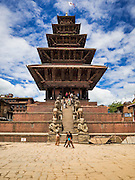 02 AUGUST 2015 - BHAKTAPUR, NEPAL:   The Nyatapola Temple is the tallest temple in Bhaktapur and one of the tallest historic structures in Nepal. It survived both the 2015 and 1934 earthquakes with no damage. Bhaktapur was badly damaged in the earthquake the hit Nepal in April 2015. The Nepal Earthquake on April 25, 2015, (also known as the Gorkha earthquake) killed more than 9,000 people and injured more than 23,000. It had a magnitude of 7.8. The epicenter was east of the district of Lamjung, and its hypocenter was at a depth of approximately 15 km (9.3 mi). It was the worst natural disaster to strike Nepal since the 1934 Nepal–Bihar earthquake. The earthquake triggered an avalanche on Mount Everest, killing at least 19. The earthquake also set off an avalanche in the Langtang valley, where 250 people were reported missing. Hundreds of thousands of people were made homeless with entire villages flattened across many districts of the country. Centuries-old buildings were destroyed at UNESCO World Heritage sites in the Kathmandu Valley, including some at the Kathmandu Durbar Square, the Patan Durbar Squar, the Bhaktapur Durbar Square, the Changu Narayan Temple and the Swayambhunath Stupa. Geophysicists and other experts had warned for decades that Nepal was vulnerable to a deadly earthquake, particularly because of its geology, urbanization, and architecture.      PHOTO BY JACK KURTZ