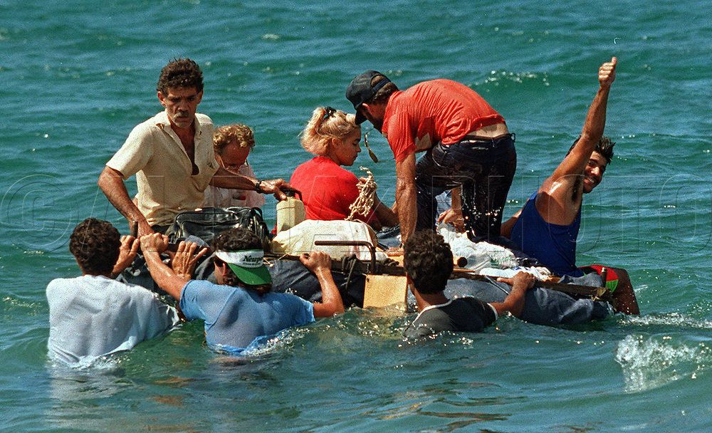 8/1994-Al Diaz/Miami Herald--In 1994 Cuban balseros turned the tiny fishing village of Cojimar into a major point of embarkation for thousands seeking a better life. Here, Cuban rafters leave Cojimar for the U.S. as others attempt to steady the raft as long as possible on its departure.