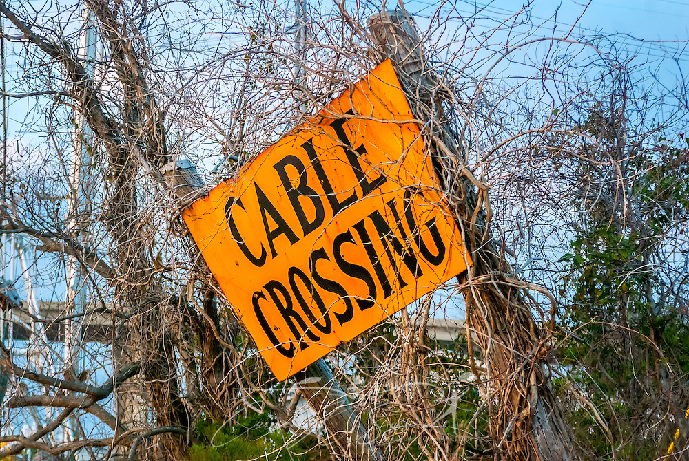 A cable crossing sign alerts marine traffic to the presence of submerged telephone cables in the East Pascagoula River, March 18, 2010, in Pascagoula, Mississippi. (Photo by Carmen K. Sisson/Cloudybright)