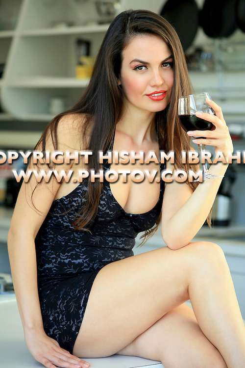 Beautiful sexy woman drinking a glass of red wine.