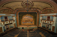 A glimpse at the original 1914 grand drape from the balcony of the Colonial Theater.  (Karen Bobotas/for the Laconia Daily Sun)