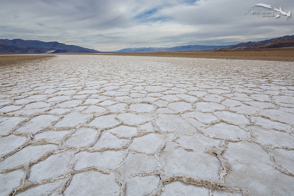 Badwater, Death Valley; at -282 feet below sea level, Badwater is the place with the lowest elevation in North America. This long channel of geometric salt crystal formations is a white scar across the center of Death Valley.