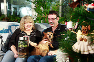 Patty and Jerry Woodbury with a terrarium they made in an art class, photographed at their home in Kettering, joined by thier dogs Bondi (left) and Sydney, Saturday, December 22, 2012.