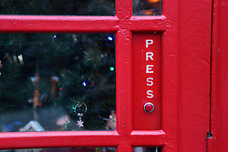 © Licensed to London News Pictures. 15/12/2016. Upper Hopton, UK. The button on a phonebox which has had a christmas conversion in the village of Upper Hopton in West Yorkshire. The button activates a toy train. Inside there is also a Christmas tree and many other lights and decorations. The display is the work of local man John Broscombe. The disused phone box bought by the community for just £1 has proved a focal point for the village Ð helping to promote local events and raising a smile with a series of animated displays at different times of the year. Photo credit : Ian Hinchliffe/LNP