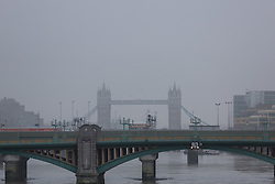 © Licensed to London News Pictures. 18/12/2016. LONDON, UK.  Tower Bridge on the River Thames is seen shrouded in fog this morning. Foggy weather continues to disrupt flights from London airports this morning.  Photo credit: Vickie Flores/LNP LNP