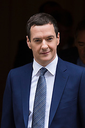 © Licensed to London News Pictures. 08/07/2015. London, UK. British Chancellor of the Exchequer, GEORGE OSBORNE leaving Number 11 Downing Street holding the Red box containing the first fully Conservative budget in 19 years.  Photo credit: Ben Cawthra/LNP