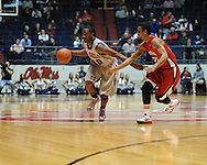 """Ole Miss' LaDarius White (10) vs. Louisiana-Lafayette's Raymone Andrews (22) at C.M. """"Tad"""" Smith Coliseum in Oxford, Miss. on Wednesday, December 14, 2011. (AP Photo/Oxford Eagle, Bruce Newman)"""
