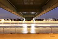 DEU, Germany, Cologne, under the Severins bridge across the river Rhine, lights of a passing ship.....DEU, Deutschland, Koeln, unter der Severinsbruecke ueber den Rhein, Lichtspuren eines Schiffes...