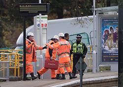 © Licensed to London News Pictures. 10/11/2016. Croydon, UK. Tram workers cross the platform at Sandilands tram station as investigations are continuing into a tram crash that police say claimed seven lives and injured 50. The driver has been arrested and is being questioned by police. Photo credit: Peter Macdiarmid/LNP