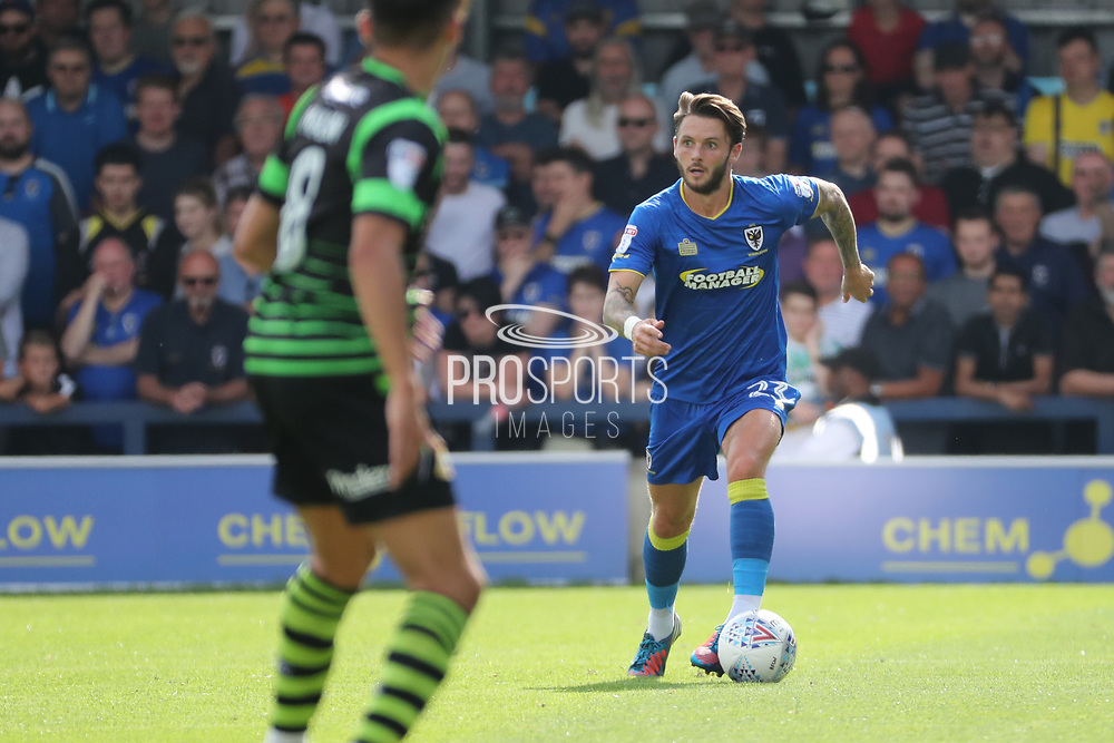 AFC Wimbledon defender Callum Kennedy (23) dribbling during the EFL Sky Bet League 1 match between AFC Wimbledon and Doncaster Rovers at the Cherry Red Records Stadium, Kingston, England on 26 August 2017. Photo by Matthew Redman.